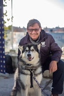 Photo of bike class instructor Phil with UW mascot Dubs