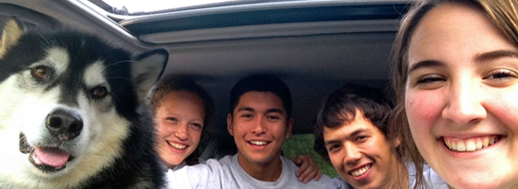 student carpoolers with dubs inside car