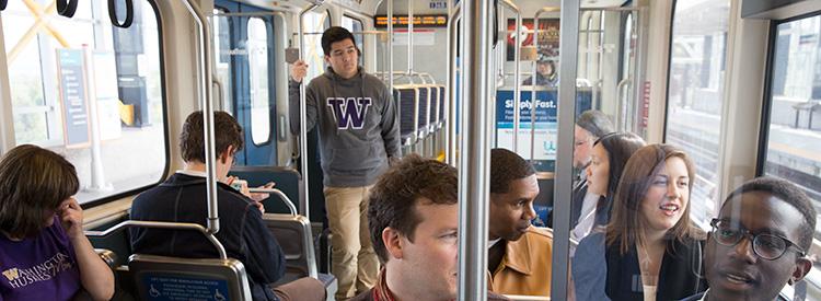 uw community members riding sound transit train