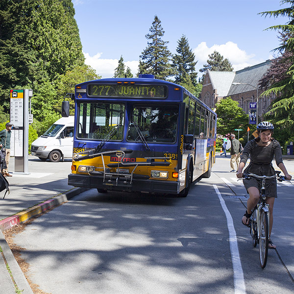 metro king county bus and bicyclist on stevens way